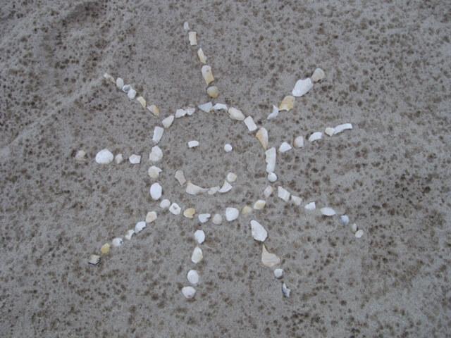 Muschelsonne_im_Sand